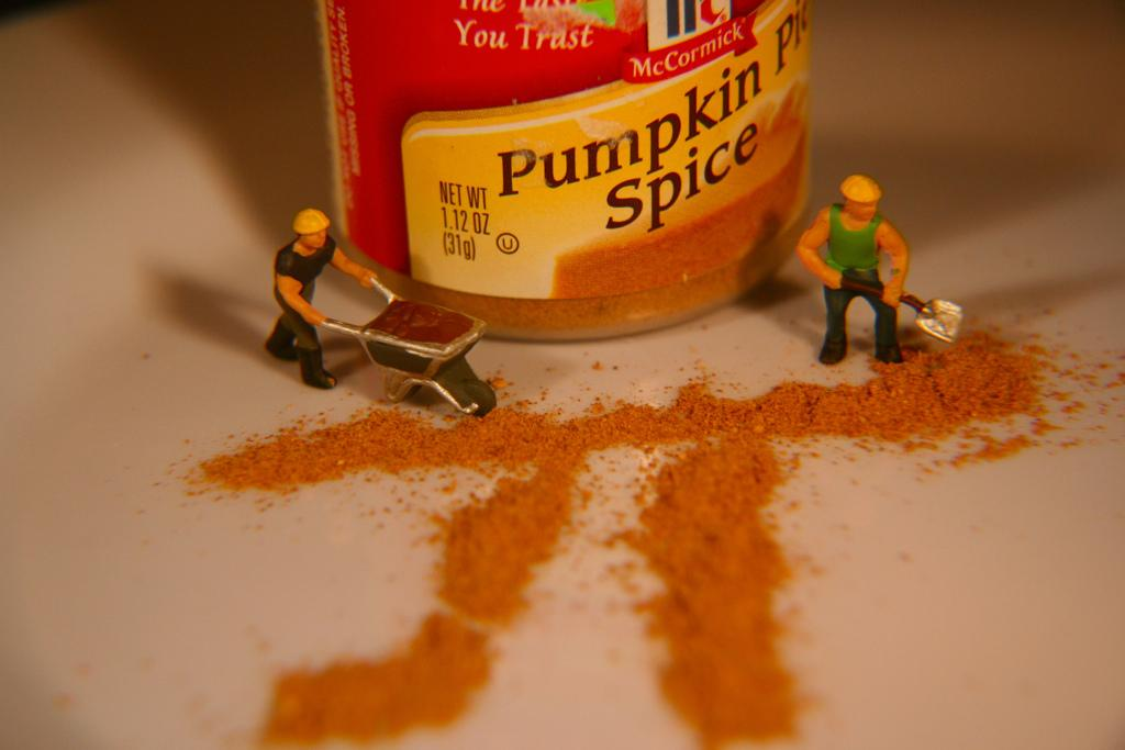 Two figurines push pumpkin spice into the shape of the mathmatecal symbol Pi. Photo by Kate Ter Haar
