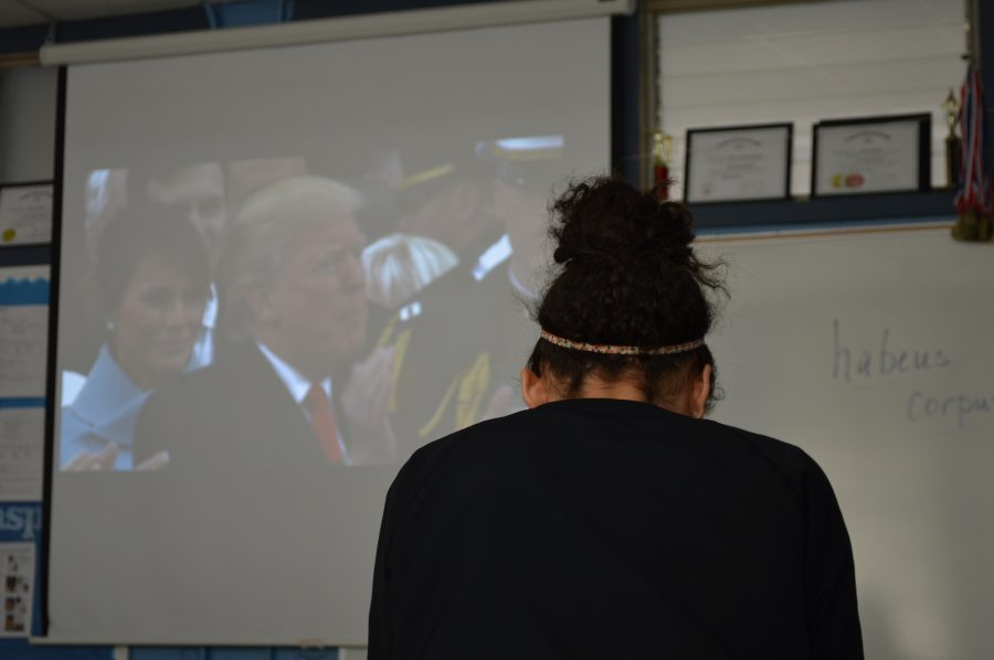 Alexandrea Lorea (12) watches live footage of Donald J. Trump's inauguration.