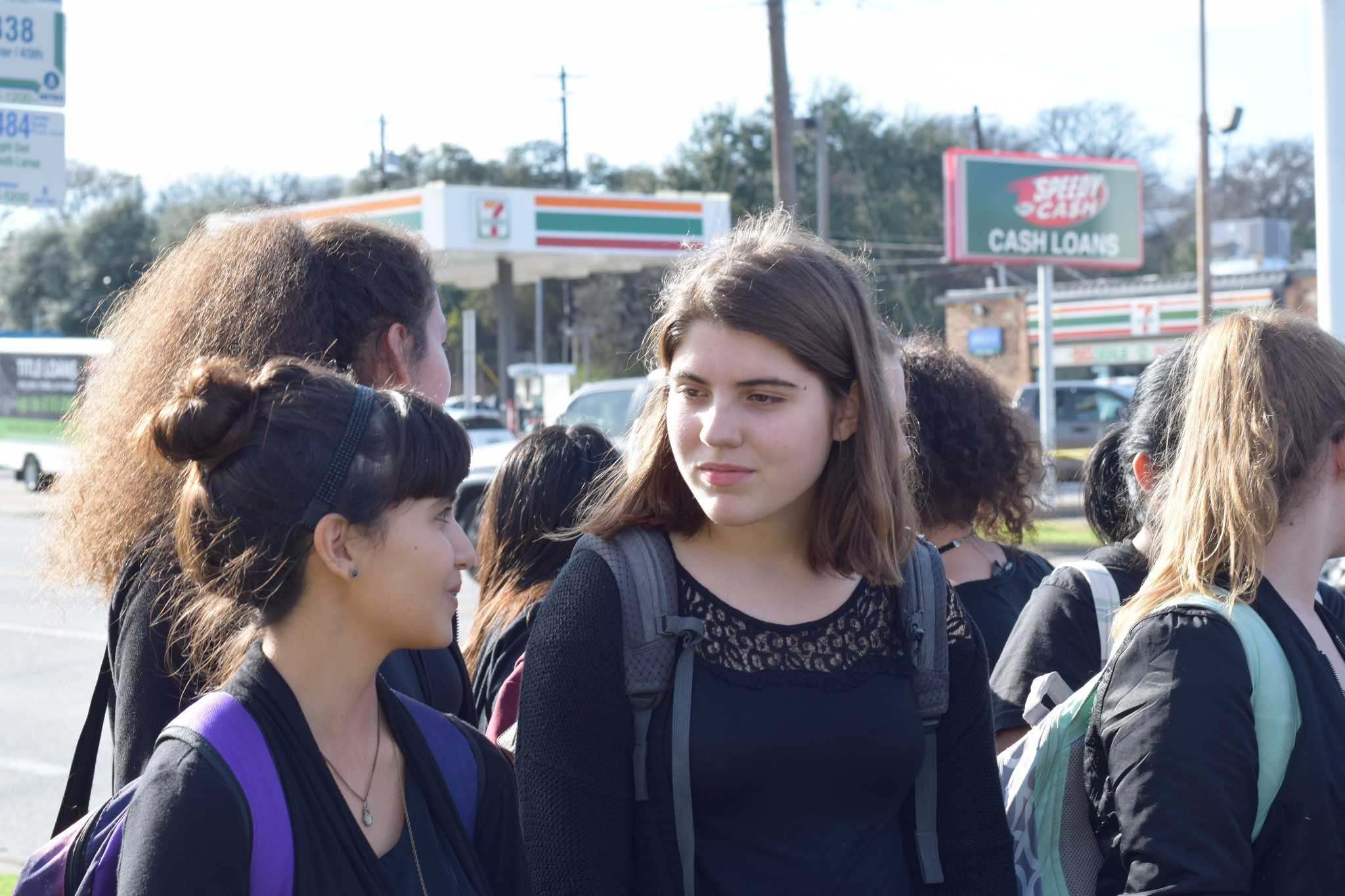 Frida Capitan-Parra (8) and Kaia Newton (8) stand with thier peers during the walk out. Photo by ARS Press.