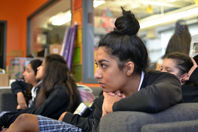 Vanity Flores (8) listens intently to the panel of Biomedical students during the first rotation of the day. Photo by Amelia Bagnaschi.