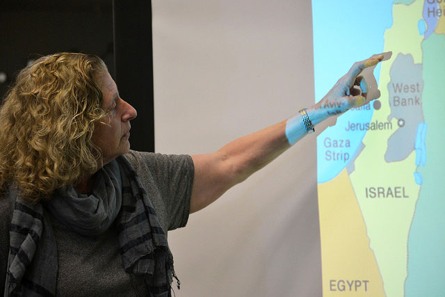 Dottie Indyke, the executive director of Creativity for Peace, projects a map to give the students knowledge of where the Israeli-Palestine conflict is happening. Photo by Prisila Samaniego (10).