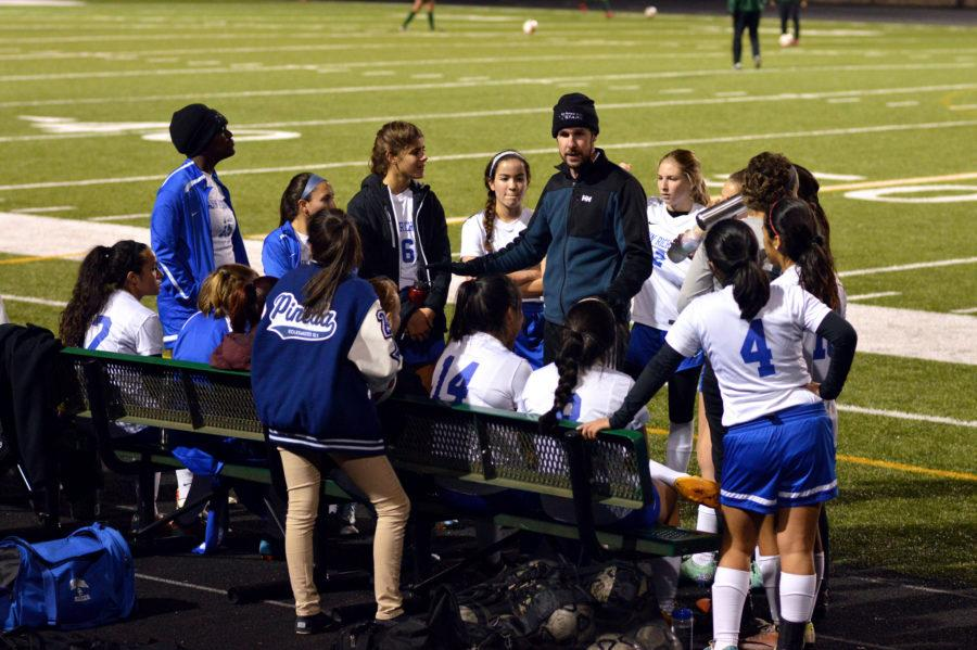 Coach+Langford+discusses+strategies+with+the+Varsity+Soccer+Team+during+halftime.++The+score+was+2-0+after+the+first+half.+Photo+by+Alexandra+Lopez.