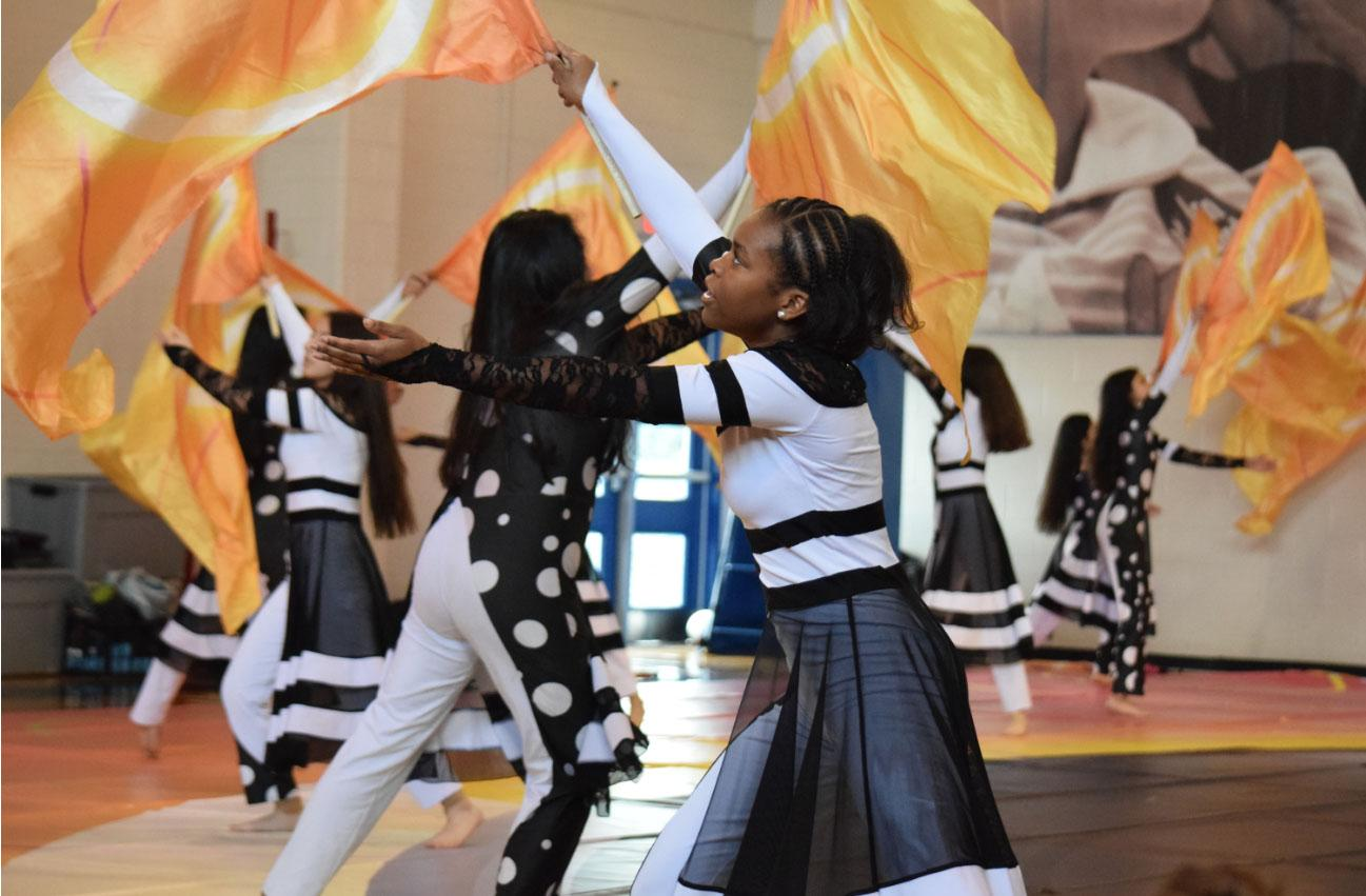 Tiana Storey (9) performs with the color guard in morning assembly.