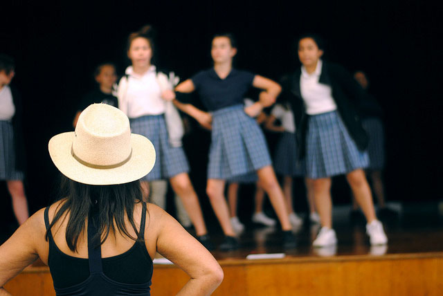 Janet Adderley watches over the musical cast as they rehearse new choreography. Photo by Fatima Rosales.