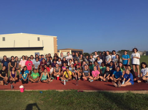 2017 Cross Country team poses for a team photo after a 3 mile run, sprints, and an ab workout. New members had just learned the pre-race chant which high school runners will use at their meet on Friday, September 1.