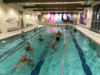 ARS swim team warms up their bodies in the LA Fitness pool before  diving into practice. Photo by Ms. Jill Dicuffa.