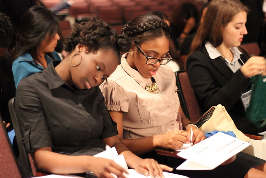 Ishajanek Overton (12) and Keira Neal (12) read a proposal at the 2016 District Youth and Government conference.  Overton and Neal participated in the State Affairs portion of the conference, held at Austin High School in Austin, Texas.