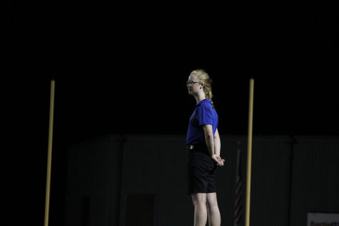 "Dana Nichols (12) prepares to lead the band. This is Nichols' second year as drum major, and fourth year in marching band. ""My favorite part about performing is the moment when, at the end of the show, everyone"