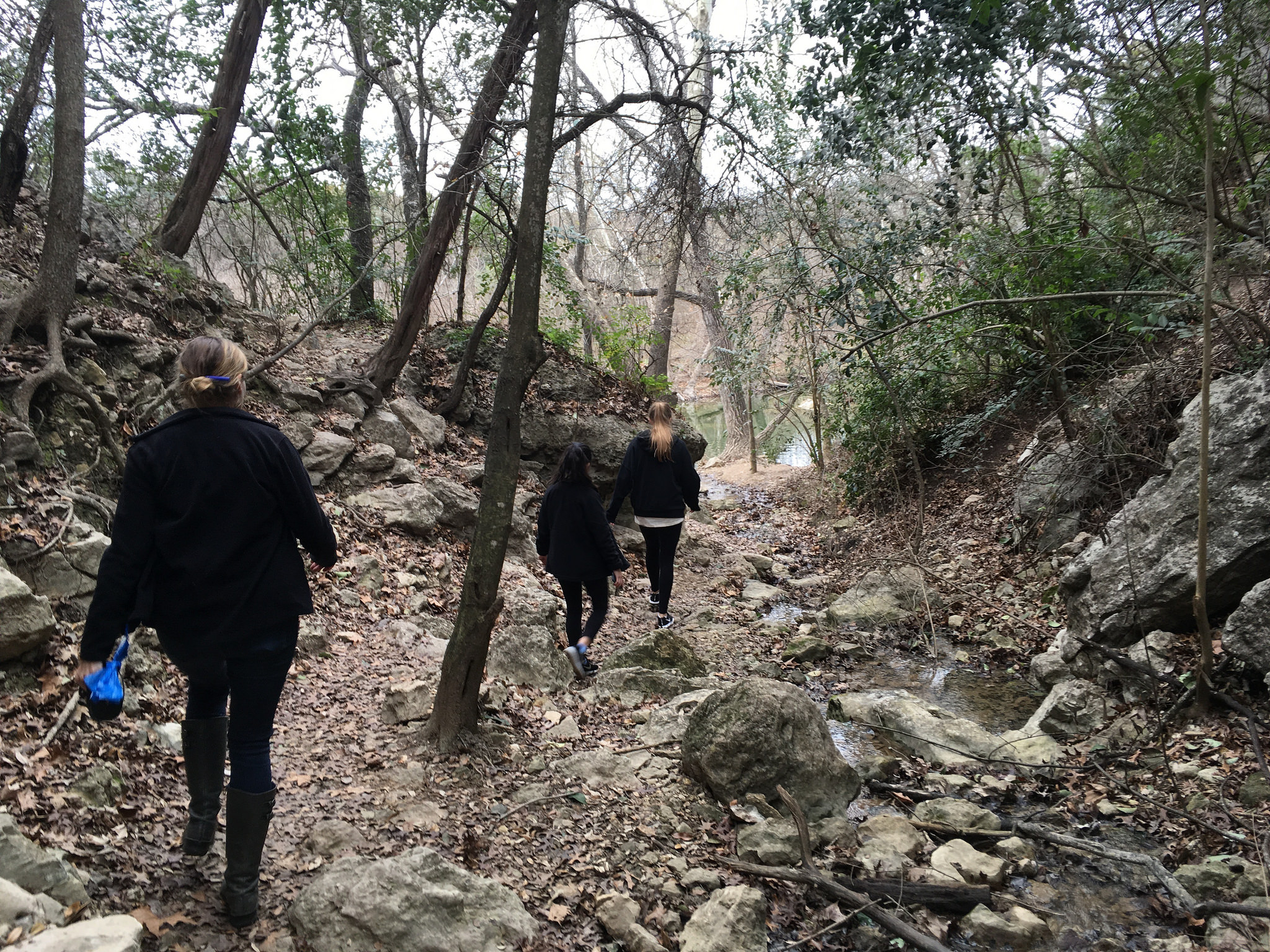 Nicole Ramirez (10), Samantha Garza (10) and Ms. Lindenburg walk along the Barton Springs trail. Their day was filled with healthy snacks, scavenger hunts, journaling, yoga, workouts and movies. Photo by Maddy Irwin.
