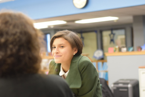 Lily Yepez (12) was talking with a friend in the office on January 3, 2018. Lily was a member of the office staff for intercession. Photo by Amanda Macias Schreiber.