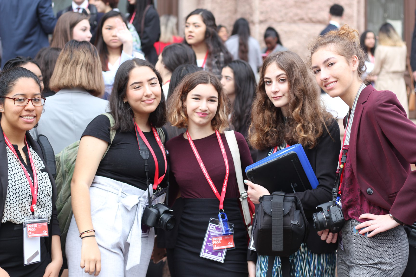 From left to right: Charlen Puon (10), Xiemena Sifuentes (10), Eleanor Jeansonne (10), Mia Clark (10), and Sierra Walton (12). Students pose for a picture during the second day of Youth and Government State Conference. All of these delegates worked in the media branch of government, which was divided into three sections: broadcast, social media, and print.  Photo by Becca Alonso.