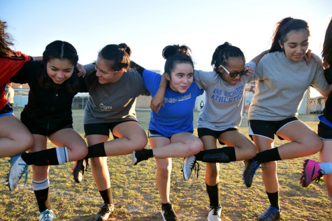 Middle school students warm up with stretches before middle school soccer tryouts in January. Photo by Ximena Sifuentes.