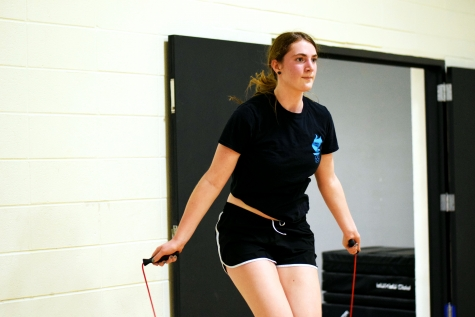 Raina Oldhem (10) jump ropes in her P.E class to her own workout. Students in 4th period P.E are learning how to create individual H.I.I.T workouts specialized for themselves.